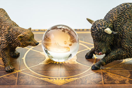 Bull and bear market, world stock exchange symbol for high and low season concept, bear and bull figures with the shinny globe with US America map in the middle. Banco de Imagens