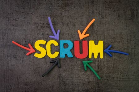 Scrum master method for agile software development concept, multi color arrows pointing to the word Scrum at the center of black cement chalkboard wall, allows a team to make changes quickly. Stockfoto