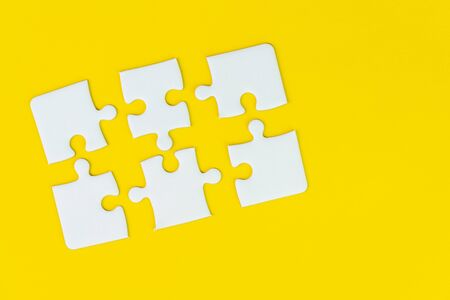 6 jigsaw puzzle on solid yellow background using as six important thing, solutions combine or working together to success or solve problem.
