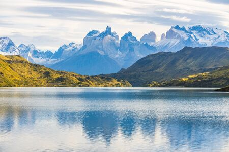 Beautiful panoramic view of lake with Cuernos, horn mountains peak with lenticular cloud in autumn, Torres del Paine national park, south Patagonia, Chile.