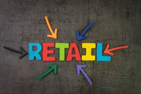 Retail, the process of selling consumer goods or services to customers concept, multi color arrows pointing to the word Retail at the center of black cement chalkboard wall.