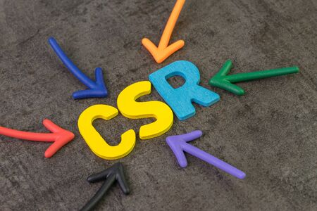 CSR, Corporate social responsibility concept, multi color arrows pointing to the abbreviation CSR at the center of black cement chalkboard wall, the activity to return profit back to people.