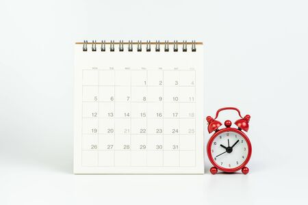 White clean calendar with red retro alarm clock on white background using as year plan, Busy work reminder, annual leave, project deadline or special event day concept.