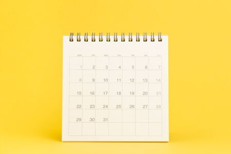 Clean desktop calendar with date 31 days on solid yellow background using as schedule planning, deadline to launch project or events and holiday reminder.