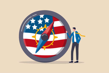 World and United States economic direction after presidential election, direction of US Federal Reserve, FED in financial crisis concept, businessman leader stand with compass with USA national flag.