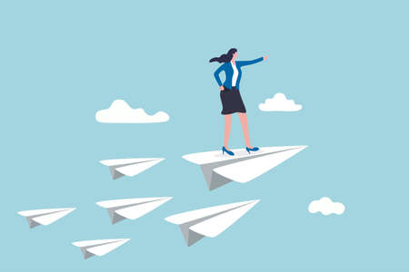 Business leadership, woman power to lead company to achieve target, smart confidence businesswoman standing on leading flying paper airplane origami pointing finger to the direction to reach goal.