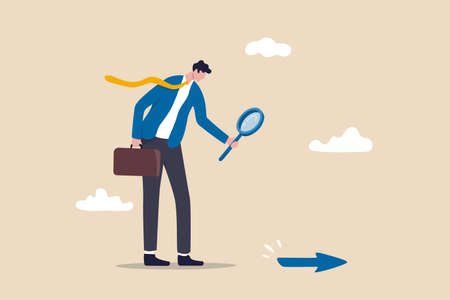 Searching for business direction, strategy or discover business opportunity or solution for work difficulty concept, businessman leader using magnifying glass to discover arrow on the floor.