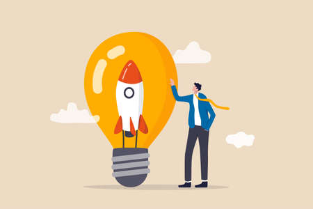 Entrepreneurship, setting up new business, motivation to create new business idea and make it success concept, businessman start up company owner standing with innovative rocket inside lightbulb idea.