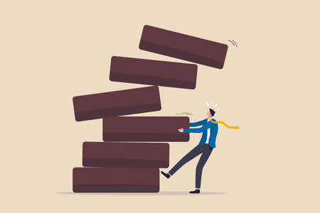 Investment risk, failure or mistake for greedy decision, business strategy to be careful and balance on instability and uncertainty concept, businessman pulling wooden block from collapsing stack.