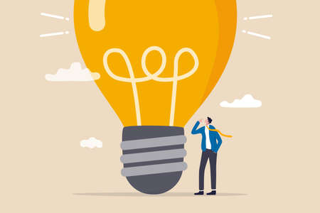 Think big, aspiration to win and success in business, big idea from creativity and imagination to overcome fear concept, smart businessman entrepreneur thinking with big oversized idea lightbulb.