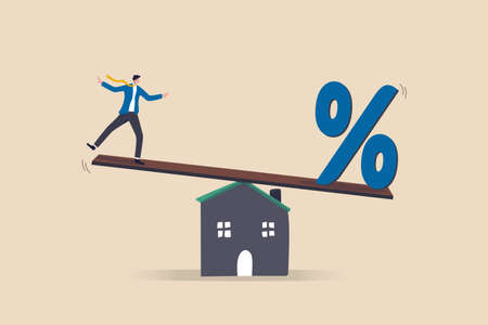 Mortgage payment, house loan interest rate or balance between income and debt or loan payment, financial risk concept, businessman trying to balance with mortgage interest rate percentage on the house