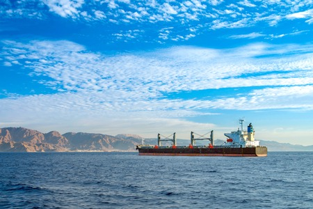 A large sea vessel in the Gulf of Aqaba. Clear sunny day. Calm sea.