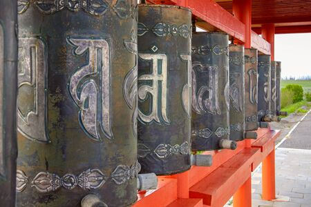 Copper Buddhist prayer drums Hurde. Exotic landmark of Kalmykia, the purpose of which is the repeated repetition of mantras.