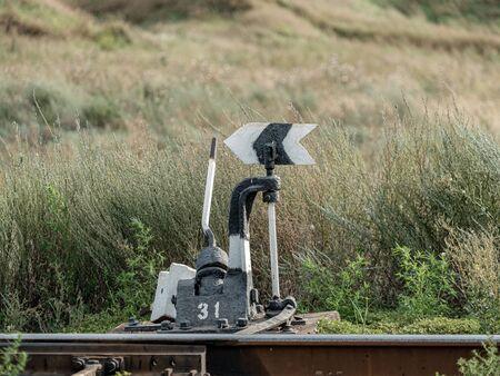 Old railroad arrow switcher. Manual rail switch mechanism. Rudiment and symbol