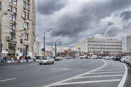 Moscow. Russia. October 24, 2019: Car traffic in the center of Moscow near Kaluga Square, near the building of the Ministry of Internal Affairs of Russia. City traffic jam on a cloudy November day. Stock Photo