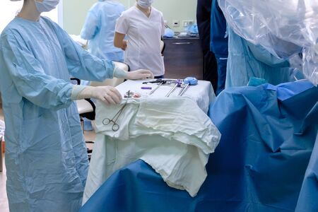 The process of carrying out a surgical operation using a modern robotic surgical system. Medical robot. Minimally invasive robotic surgery.
