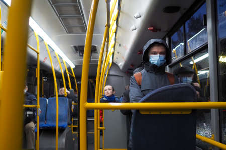 Moscow. Russia. October 9, 2020. A man in a city bus wearing a protective medical mask. Preventive measures for viral infections. The second wave of the coronavirus pandemic