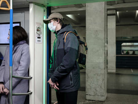 Moscow. Russia. October 19, 2020. A man in a subway car. The passenger has a protective medical mask on the face. Preventive measures for viral infections. Second wave of coronavirus.