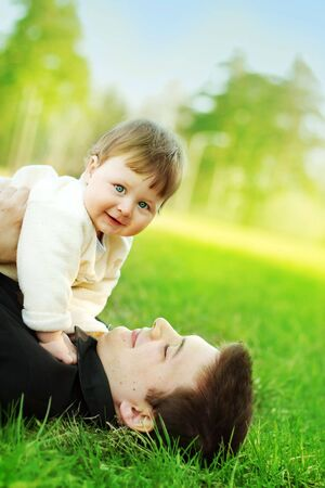 portrait of happy father and son on the grass