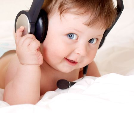 face portrait of beautiful baby with headset