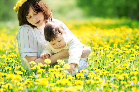 portrait of mother and son on the grass Stock Photo - 3101950