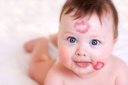 portrait of baby with kisses on his face