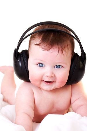 portrait of beautiful smiling baby with earphones