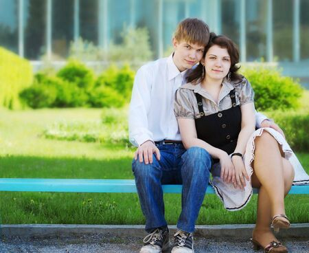 portrait of young couple in the park photo