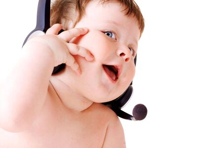 face portrait of smiling baby with headset Stock Photo