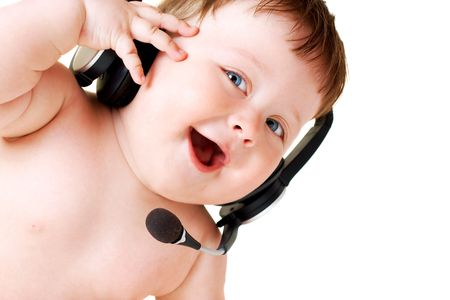 portrait of baby with headset on white background