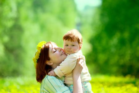 portrait of mother and son on the grass Stock Photo