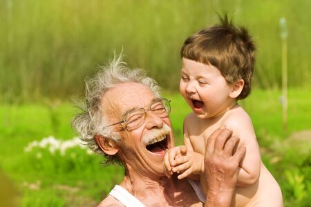 portrait of grandfather and grandson on nature background