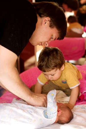 father and son look at newborn baby Stock Photo - 4941074