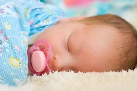 portrait of beautiful sleeping baby in blue diaper Stock Photo - 4941079