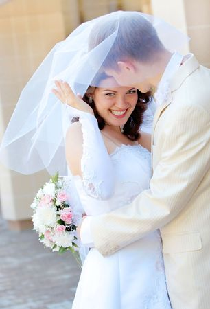 beautiful young bride and groom stand together