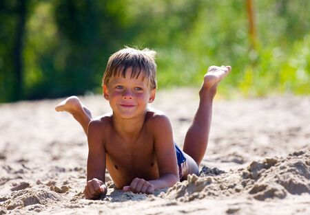 boy feet: portrait of happy child on the beach Stock Photo