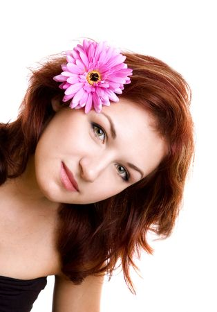 portrait of beautiful girl with flower in the hair photo