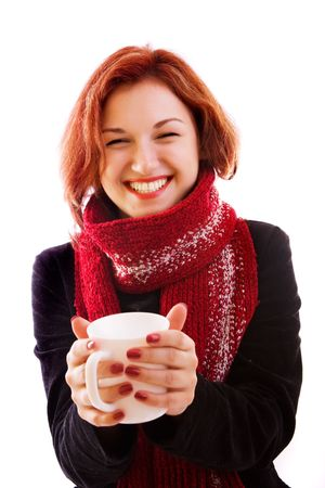 portrait of girl in winter clothes with cup photo