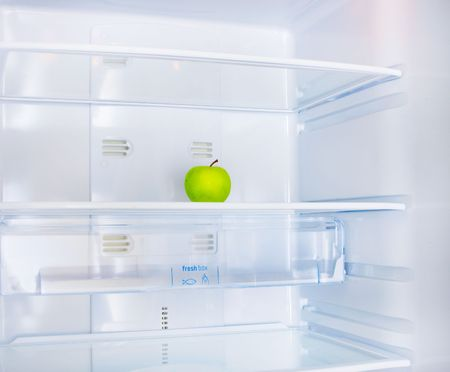 green apple in the empty white fridge Stock Photo