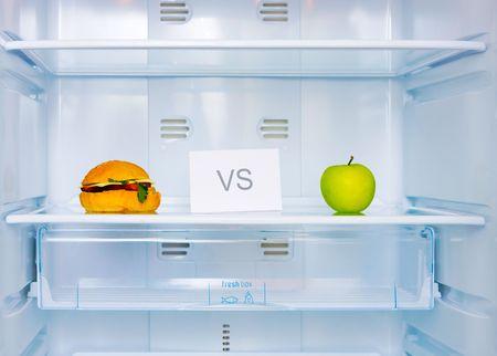 big sandwich and green apple in the empty white fridge photo