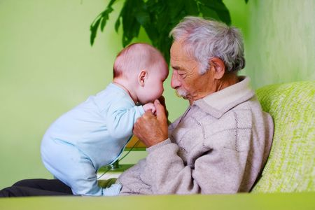 portrait of happy baby with old grandpa Stock Photo