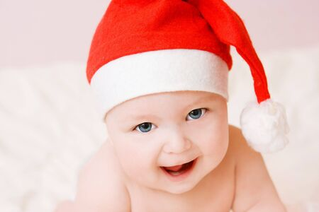 portrait of sweet baby in christmas hat Stock Photo