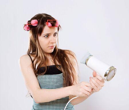 woe: portrait of sad girl with broken hairdryer