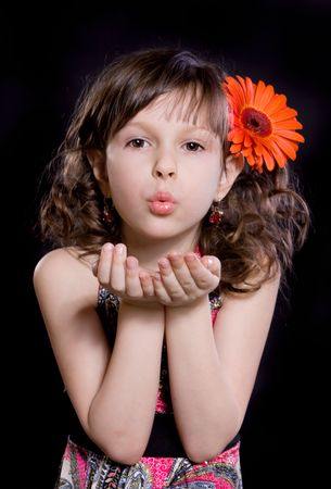 blow kiss: portrait of girl with flower in the hair