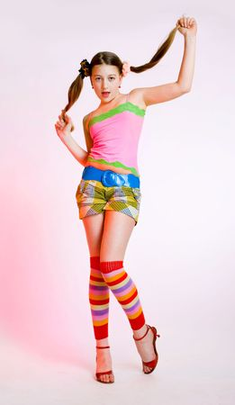 gaiters: full length portrait of teenage girl on pink background Stock Photo