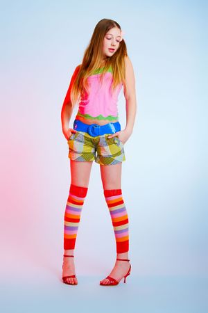 gaiters: teenage girl in bright clothes on blue background