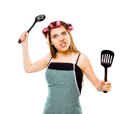 unkind: portrait of crazy housewife with kitchen utensils