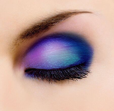 smoky eyes: closeup of female eye with beautiful make-up