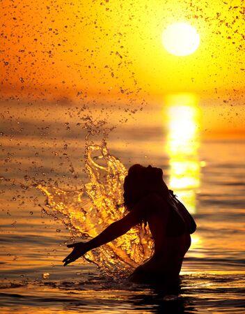 beautiful woman's silhouette in the sea Stock Photo