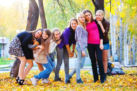 top seven: many young girls in the park. View from top.